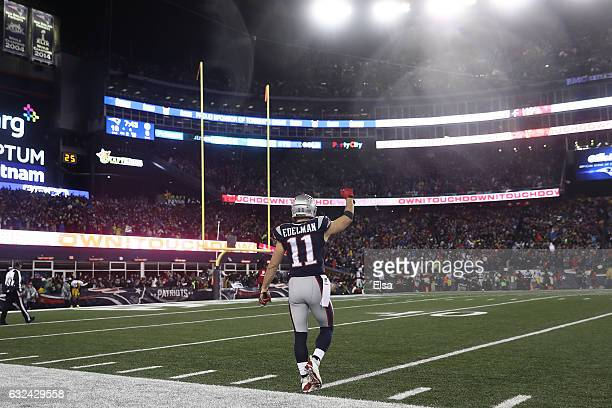 Julian Edelman of the New England Patriots celebrates a score against the Pittsburgh Steelers during the second quarter in the AFC Championship Game...