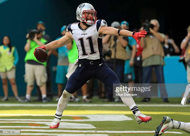 Julian Edelman of the New England Patriots celebrates a two point conversion during a game against the Miami Dolphins at Hard Rock Stadium on January...