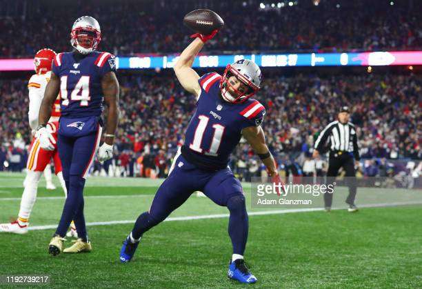 Julian Edelman of the New England Patriots celebrates scoring a touchdown during the first quarter against the Kansas City Chiefs in the game at...