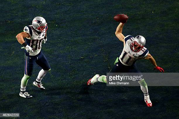 Julian Edelman of the New England Patriots celebrates scoring on a three yard touchdown pass as Danny Amendola looks on in the fourth quarter against...