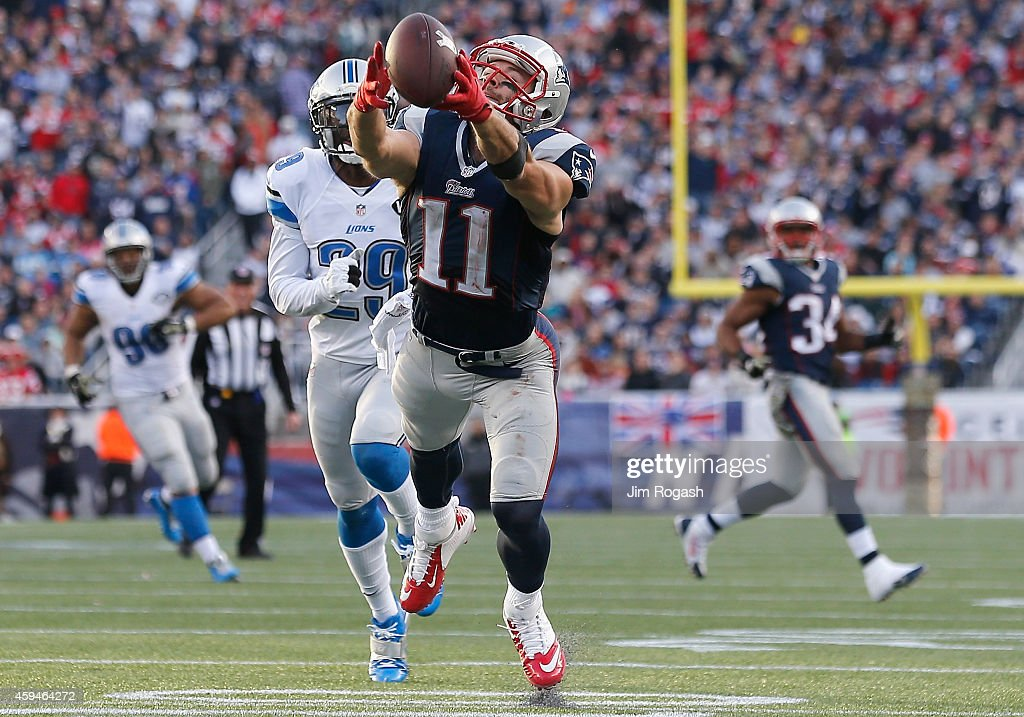 Julian Edelman #11 of the New England Patriots dives as he attempts to catch a pass during the third quarter against the Detroit Lions at Gillette Stadium on November 23, 2014 in Foxboro, Massachusetts.