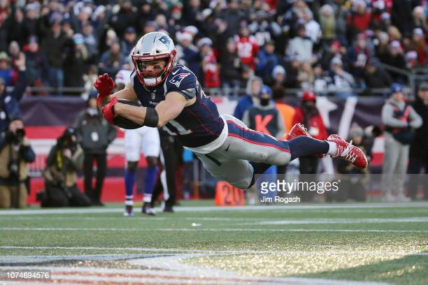 Julian Edelman of the New England Patriots dives for the end zone to score a 32yard receiving touchdown during the third quarter against the Buffalo...
