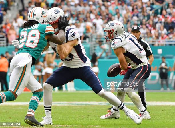 Julian Edelman of the New England Patriots fumbles in the second half against the Miami Dolphins at Hard Rock Stadium on December 9 2018 in Miami...