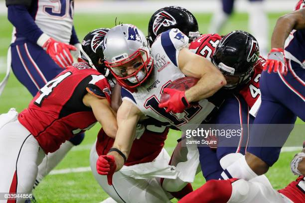 Julian Edelman of the New England Patriots is tackled in the first quarter by the Atlanta Falcons defense during Super Bowl 51 at NRG Stadium on...