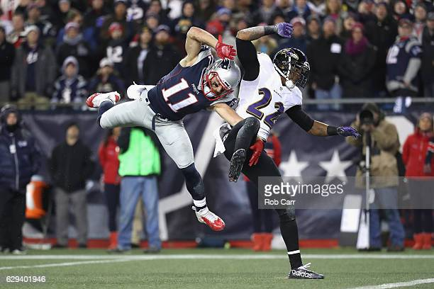 Julian Edelman of the New England Patriots is unable to catch a pass during the first half as he is defended by Jimmy Smith of the Baltimore Ravens...