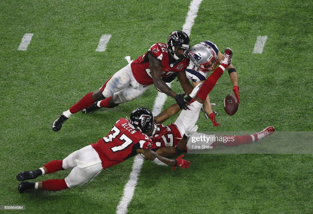 Julian Edelman #11 of the New England Patriots makes a 23 yard catch in the fourth quarter against Ricardo Allen #37, Robert Alford #23 and Keanu Neal #22 of the Atlanta Falcons during Super Bowl 51 at NRG Stadium on February 5, 2017 in Houston, Texas.