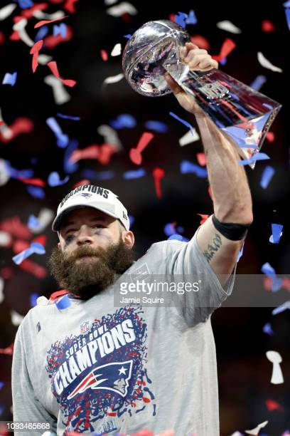 Julian Edelman of the New England Patriots raises the Vince Lombardi Trophy after the Patriots defeat the Los Angeles Rams 133 during Super Bowl LIII...