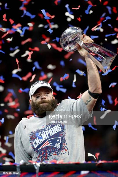 Julian Edelman of the New England Patriots raises the Vince Lombardi Trophy after the Patriots defeat the Los Angeles Rams 13-3 during Super Bowl...