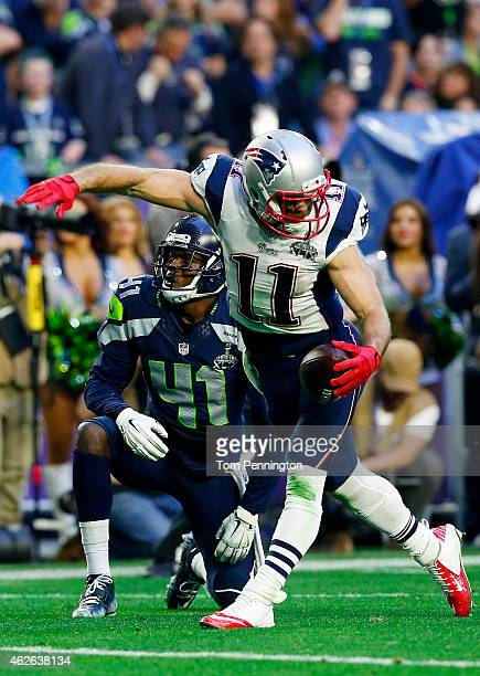 Julian Edelman of the New England Patriots reacts after making a catch over Byron Maxwell of the Seattle Seahawks in the second quarter during Super...