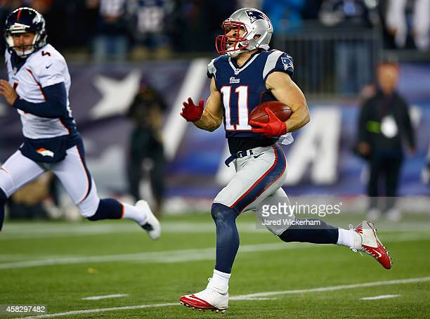 Julian Edelman of the New England Patriots returns a kick for a touchdown during the second quarter against the Denver Broncos at Gillette Stadium on...