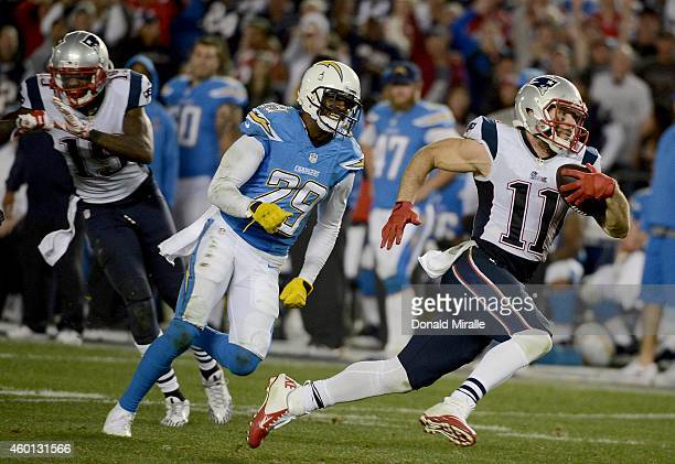 Julian Edelman of the New England Patriots runs for a touchdown against Shareece Wright of the San Diego Chargers during an NFL game at Qualcomm...