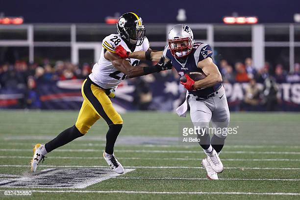Julian Edelman of the New England Patriots runs with the ball against Sean Davis of the Pittsburgh Steelers during the second half of the AFC...