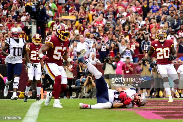 Julian Edelman of the New England Patriots scores a first quarter touchdown against the Washington Redskins in the game at FedExField on October 06...