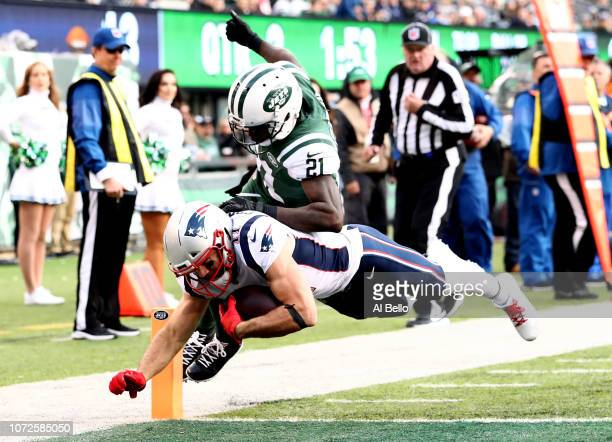 Julian Edelman of the New England Patriots scores a touchdown against Morris Claiborne and Jamal Adams of the New York Jets during their game at...