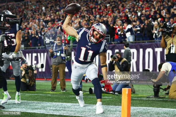 Julian Edelman of the New England Patriots spikes the football after scoring a touchdown in the second quarter of a game against the Kansas City...