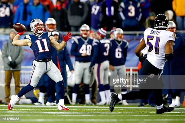 Julian Edelman of the New England Patriots throws a touchdown pass on a flea flicker play during the second half of the 2015 AFC Divisional Playoffs...