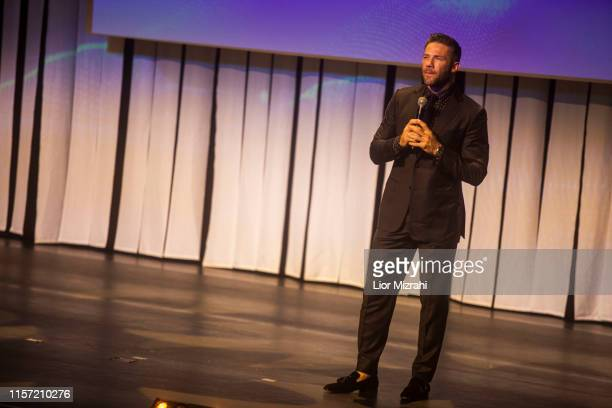Julian Edelman performs on stage during the Genesis Prize ceremony at The Jerusalem Theater on June 20 2019 in Jerusalem Israel