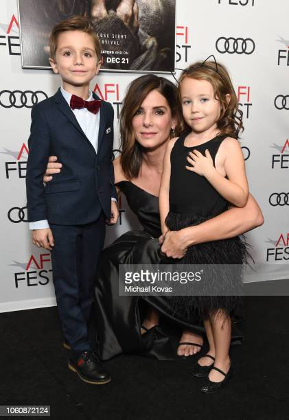 Julian Edwards Sandra Bullock and Vivien Lyra Blair attend the gala screening of Bird Box during AFI FEST 2018 on November 5 2018 in Los Angeles...