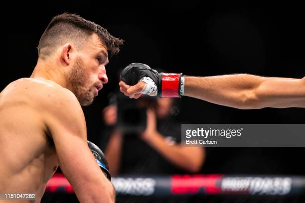 Julian Erosa avoids a punch thrown by Julio Arce during the first round of a featherweight bout at Blue Cross Arena on May 18, 2019 in Rochester, New...