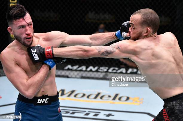 Julian Erosa punches Sean Woodson in their fight during the UFC Fight Night event at UFC APEX on June 27 2020 in Las Vegas Nevada
