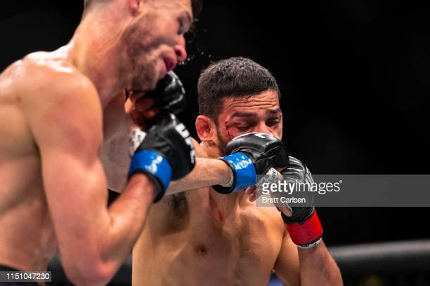Julian Erosa trades blows with Julio Arce during round three of a featherweight bout at Blue Cross Arena on May 18, 2019 in Rochester, New York. Arce...
