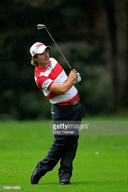 Julian Etulain of Argentina hits his approach to the second green during the final round of the weather shortened Pacific Rubiales Bogota Open...