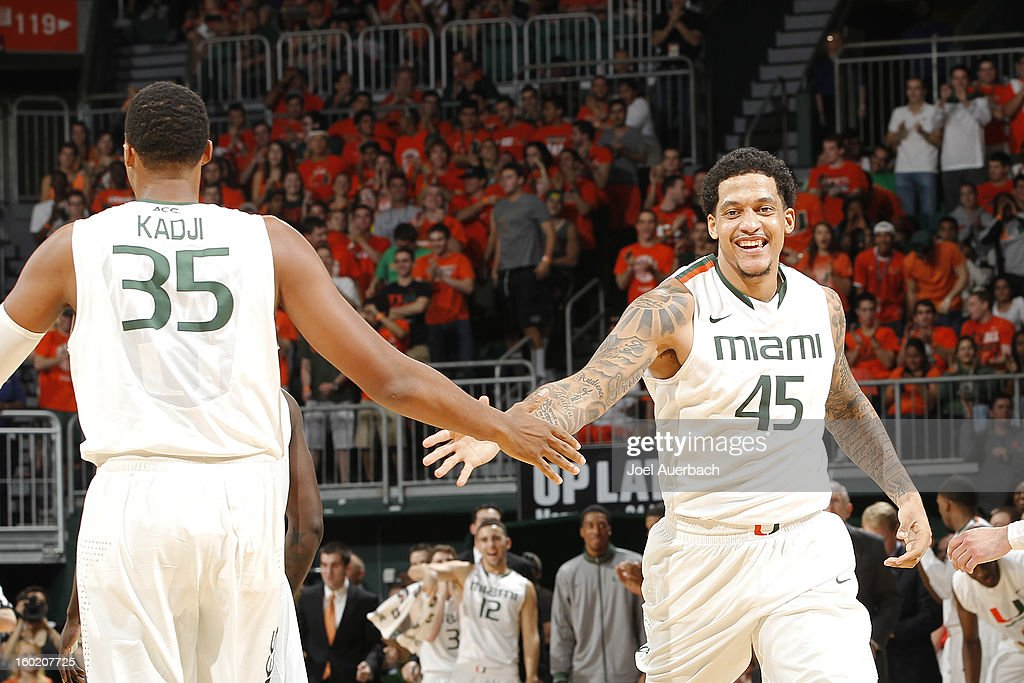 Julian Gamble #45 is congratulated by Kenny Kadji #35 of the Miami Hurricanes after dunking the ball against the Florida State Seminoles on January 27, 2013 at the BankUnited Center in Coral Gables, Florida. The Hurricanes defeated the Seminoles 71-47.