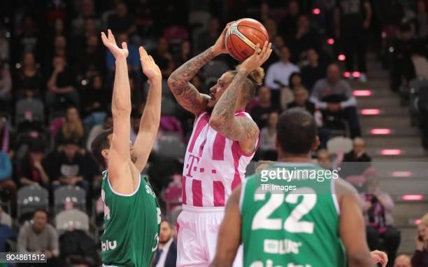 Julian Gamble of Bonn and Adam Hrycaniuk of Zielona Gora battle for the ball during the Basketball Champions League match between Telekom Baskets...