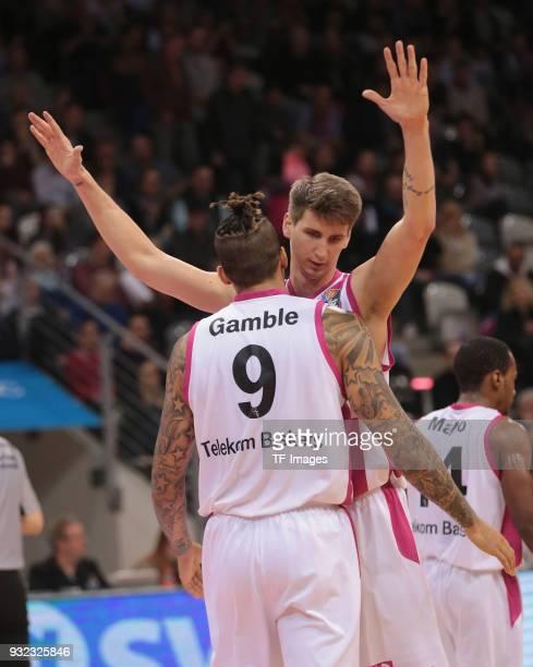 Julian Gamble of Bonn and Tomislav Zubcic of Bonn gesture during the Basketball Bundesliga match between Telekom Baskets Bonn and Science City Jena...