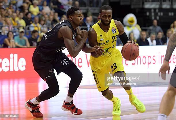 Julian Gamble of Telekom Baskets Bonn and Dominique Johnson of Alba Berlin during the easyCredit Basketball Bundesliga game between Alba Berlin and...