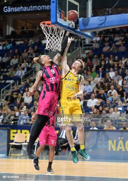 Julian Gamble of Telekom Baskets Bonn and Marius Grigonis of Alba Berlin during the game between Alba Berlin and the Telekom Baskets Bonn at...