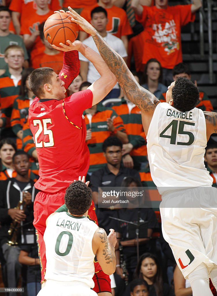 Julian Gamble #45 of the Miami Hurricanes blocks the shot by Alex Len #25 of the Maryland Terrapins on January 13, 2013 at the BankUnited Center in Coral Gables, Florida. Miami defeated Maryland 54-47.