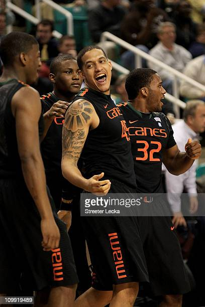 Julian Gamble of the Miami Hurricanes celebrates with teammates DeQuan Jones and Erik Swoope during the second half of the game against the Virginia...