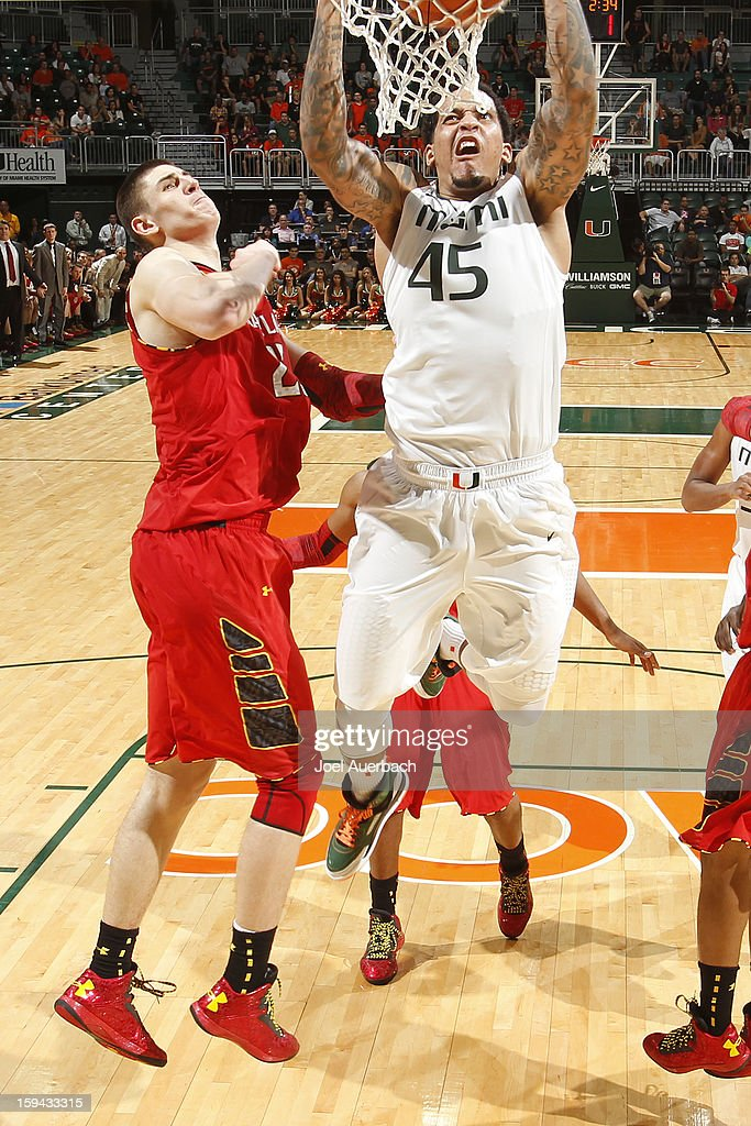 Julian Gamble #45 of the Miami Hurricanes goes to the basket past Alex Len #25 of the Maryland Terrapins late in the second half of the game on January 13, 2013 at the BankUnited Center in Coral Gables, Florida. Miami defeated Maryland 54-47.