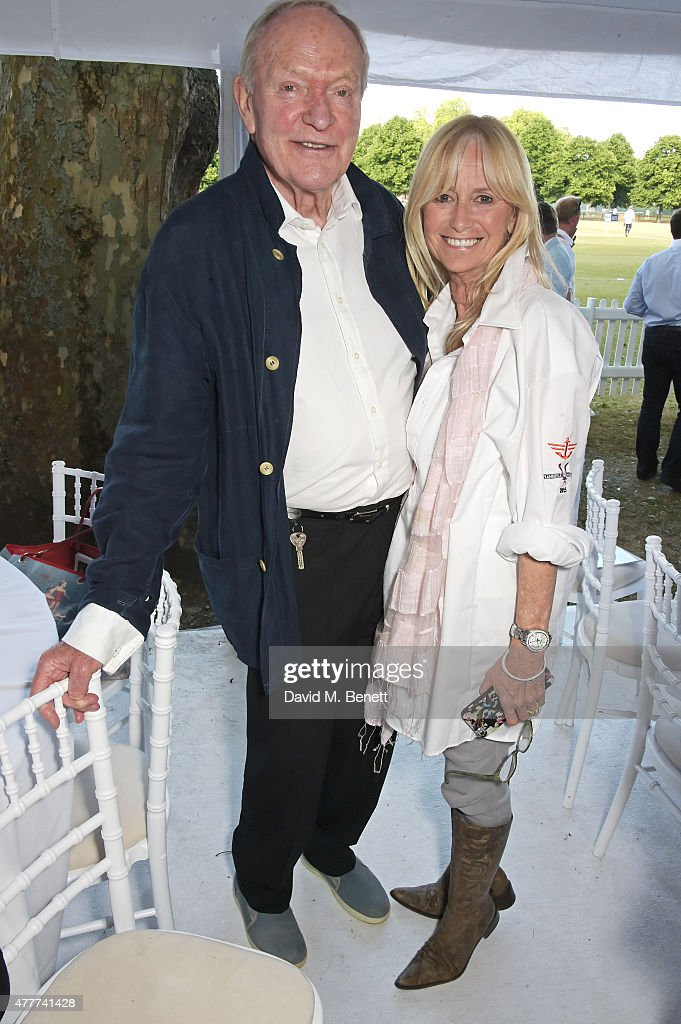 Julian Glover (L) and Susan George attend the Flannels for Heroes charity cricket match and garden party hosted by menswear brand Dockers at Burtons Court on June 19, 2015 in London, England.