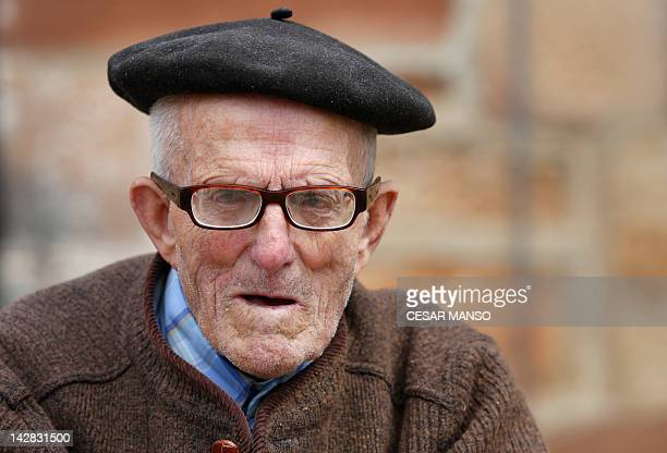 Julian Gonzalez an elderly Spanish man, poses in front of his house in Revilla del Campo, near Burgos on April 13, 2012. AFP PHOTO / CESAR MANSO