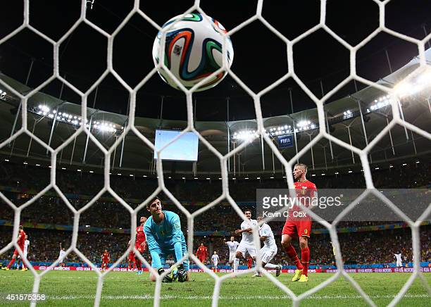 Julian Green of the United States scores his team's first goal past Thibaut Courtois of Belgium in extra time during the 2014 FIFA World Cup Brazil...