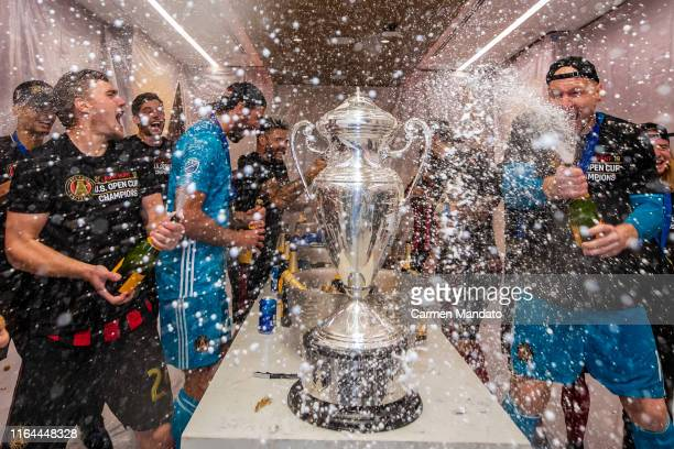 Julian Gressel and Brad Guzan of Atlanta United celebrate after defeating Minnesota United 21 to win the US Open Cup Final at MercedesBenz Stadium on...