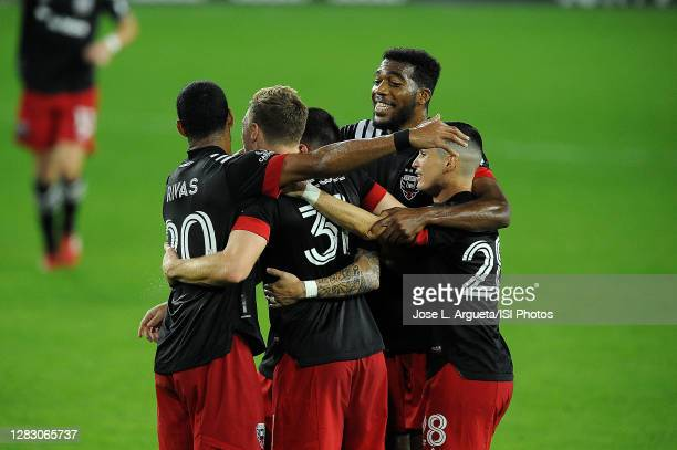 Julian Gressel of D.C. United celebrates his score with teammates during a game between Columbus Crew and D.C. United at Audi Field on October 28,...