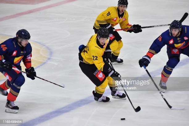 Julian Grosslercher of Vienna is challenged by Albin Grewe of Stockholm and Robin Norell of Stockholm during the Champions Hockey League match...