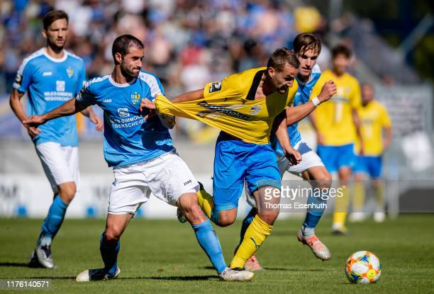 Julian Guenther Schmidt of Jena is fouled by Rafael Garcia Doblas of Chemnitz during the 3. Liga match between Chemnitzer FC and FC Carl Zeiss Jena...