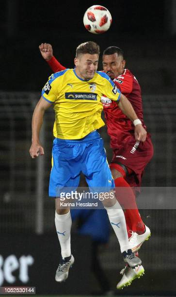 Julian GuentherSchmidt of Jena and Royal Dominique Fennell of Aalen jump for a header during the third Liga match between FC Carl Zeiss Jena and VfR...