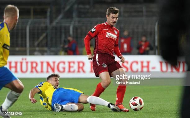 Julian GuentherSchmidt of Jena challenges Thomas Geyer of Aalen during the third Liga match between FC Carl Zeiss Jena and VfR Aalen at...
