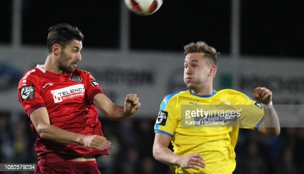 Julian GuentherSchmidt of Jena challenges Torben Rehfeldt of Aalen during the third Liga match between FC Carl Zeiss Jena and VfR Aalen at...