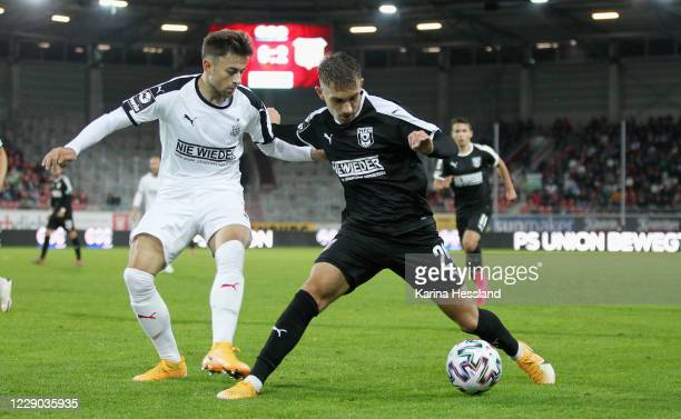 Julian Guttau of Hallescher challenges Marcus Godinho of Zwickau during the 3.Liga match between Hallescher FC and FSV Zwickau at Erdgas Sportpark on...
