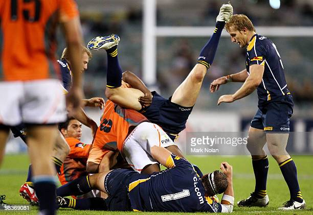 Julian Huxley of the Brumbies is dumped by Kabamba Floors of the Cheetahs during the round nine Super 14 match between the Brumbies and the Cheetahs...