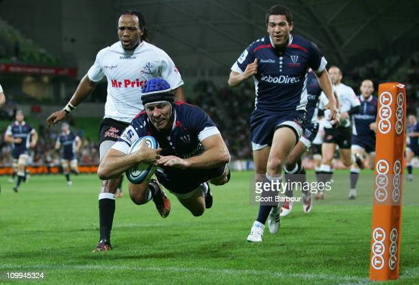 Julian Huxley of the Rebels dives to score a try during the round four Super Rugby match between the Melbourne Rebels and the Sharks at AAMI Park on...