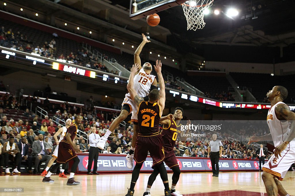 Julian Jacobs #12 of the USC Trojans drives to the basket against Eric Jacobsen #21 of the Arizona State Sundevils during a NCAA Pac12 college basketball game at Galen Center on January 7, 2016 in Los Angeles, California.