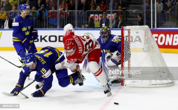 Julian Jakobsen of Denmark challenges Nicklas Backstrom of Sweden for the puck during the 2017 IIHF Ice Hockey World Championship game between...
