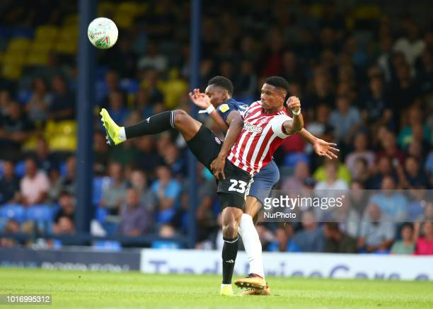 Ryan Woods of Brentford holds of Simon Cox of Southend United during Carabao Cup 1st Round match between Southend United and Brentford at Roots Hall...